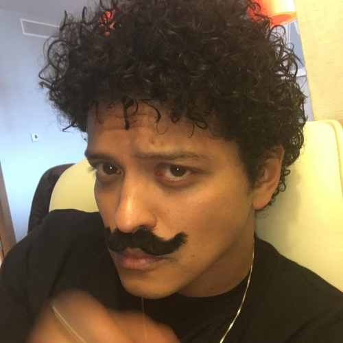 bruno mars mustache with curly hairstyle