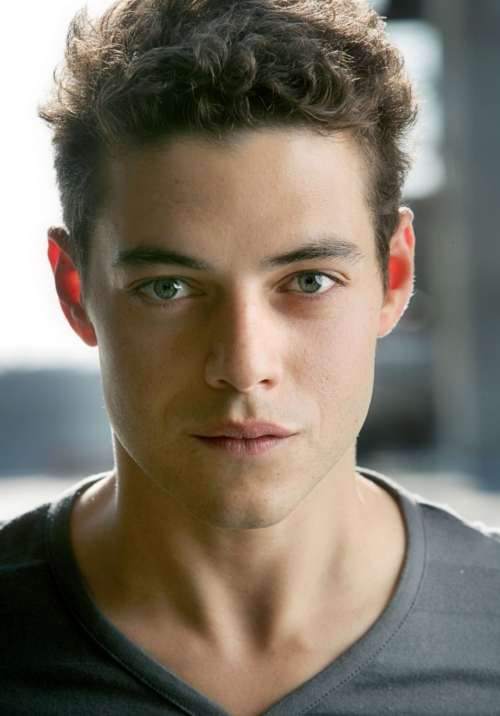 rami malek short pomp with side part haircut