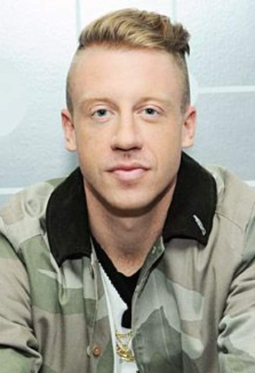 macklemore bald fade side part hairstyle