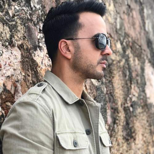 luis fonsi side part fade haircut