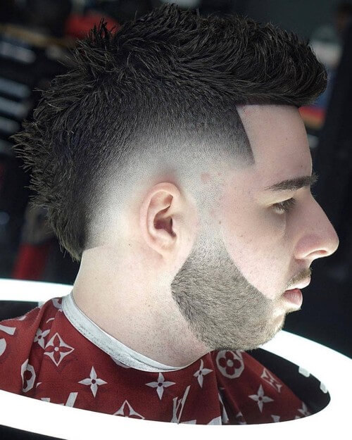 spiky mohawk fade hairstyle with bald skin side part hairstyle