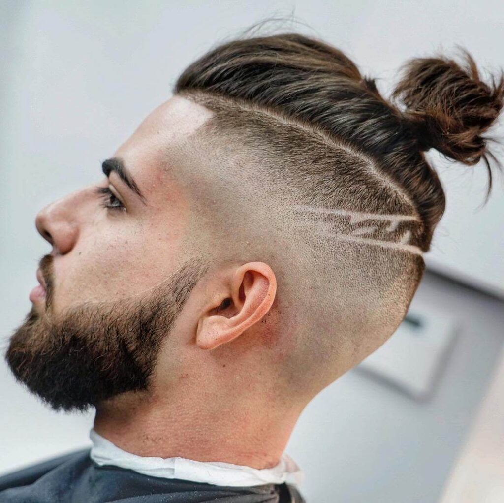 criztofferson bald fade skin mid fade man bun long hair