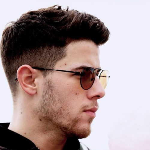 nick jonas side part haircut