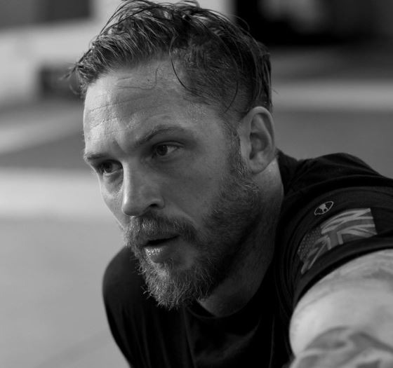 tom hardy hairstyle long hair with side part taper fade