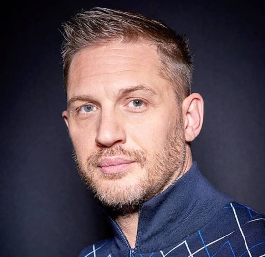 tom hardy taboo haircut with side part fade